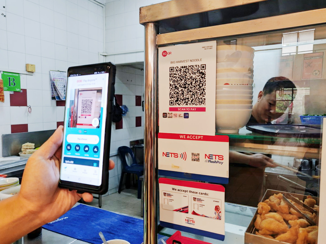 NETS QR codes like this one at the Big Harvest Ban Mian stall in Canteen 14 are available at most establishments in NTU. Mobile payments have become a common way to pay for food in the university. (PHOTO: Osmond Chia)