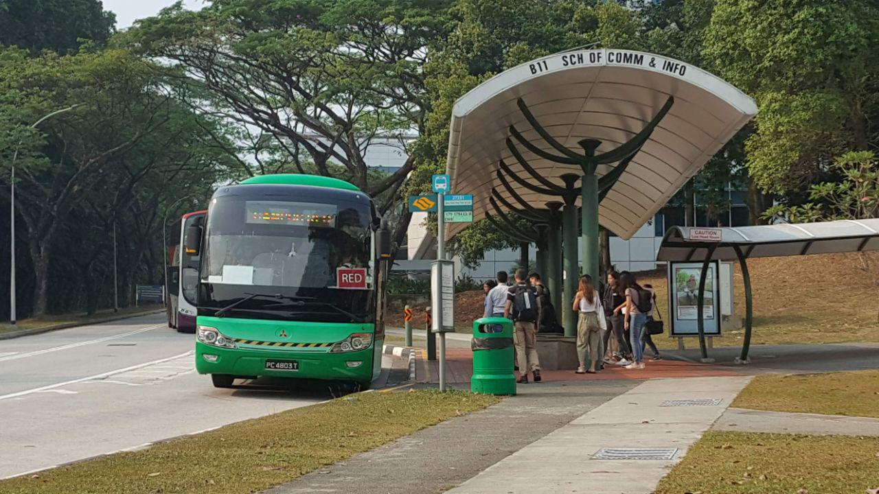 Campus Red Rider alighting passengers at a bus stop. (PHOTO: Yong Jun Yuan)